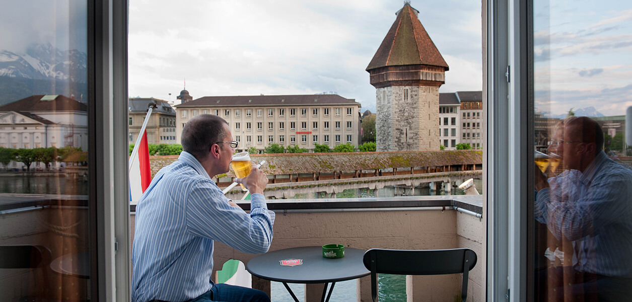 Enjoying a drink and the view after a day in Lucerne!